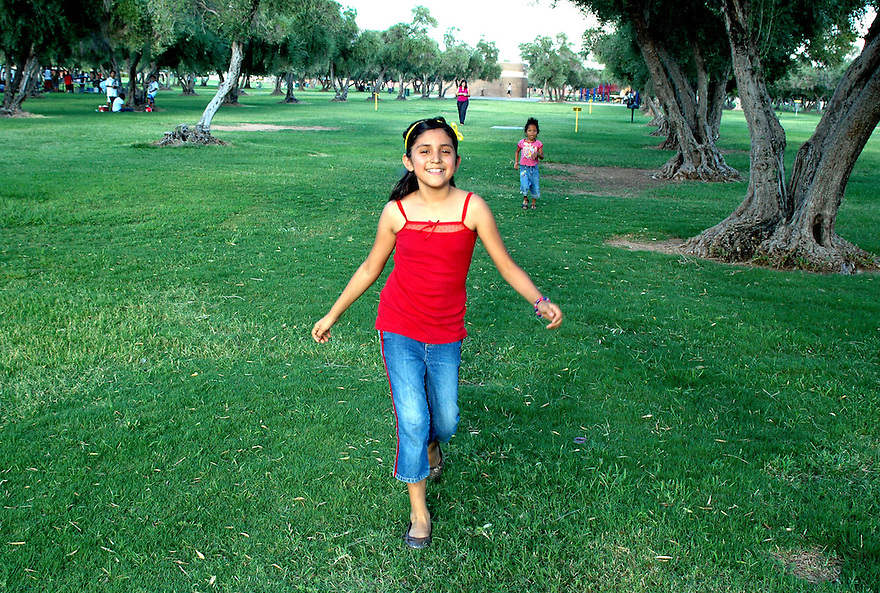 AJ Alexander -  Kathy Figueroa At the park enjoying the evening while raiseing money to get her parents out of jail..Photo by AJ Alexander