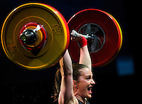 10 MAY 2014 - COVENTRY, GBR - Sarah Davies from the Paul Furness School of Weightlifting celebrates a lift during the women's 63kg category round at the British 2014 Senior Weightlifting Championships and final 2014 Commonwealth Games qualifying event round at the Ricoh Arena in Coventry, Great Britain. Davies' combined total for the event of 191kg makes her eligible for selection for the England team for the Commonwealth Games in Glasgow (PHOTO COPYRIGHT © 2014 NIGEL FARROW, ALL RIGHTS RESERVED)