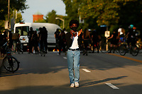 Protesters marched through East Liberty to Point Breeze before staging a sit-in outside of the home of Mayor Bill Peduto on Tuesday August 18, 2020 in Pittsburgh, Pennsylvania.  (Photo by Jared Wickerham/Pittsburgh City Paper)