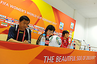 Kwang Min Kim (l), Coach of North Korea, and player Yun Mi Jo (r) during a press conference at the FIFA Women's World Cup at the FIFA Stadium in Dresden, Germany on June 27th, 2011.