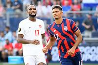 KANSAS CITY, KS - JULY 18: Cyle Larin #17 of Canada .Miles Robinson #12 of the United States during a game between Canada and USMNT at Children's Mercy Park on July 18, 2021 in Kansas City, Kansas.