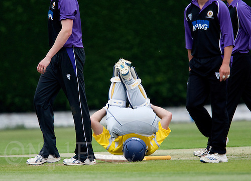 25 JUN 2009 - LOUGHBOROUGH,GBR - A Derbyshire player stretches during a break in the match against Loughborough UCCE - UCCE Twenty 20 (PHOTO (C) NIGEL FARROW)