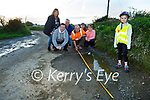 Residents in Kilmoyley seriously concerned about the safety and the state of the road in Tochar Bán. Front right Aoife Aylward. Back l to r: Liz Denault, Mike Griffin, Des Griffin, Paddy O'Sullivan,Tomas Aylward and Kathleen O'Sullivan .
