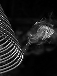 Bao-jhong Yi-min Temple, Kaohsiung -- Smoke rising from an incense coil under the temple roof.