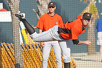 Oliver Drake #52 of the Frederick Keys throwing in the bullpen before a game against the Myrtle Beach Pelicans on May 1, 2010 in Myrtle Beach, SC. In the background is Keys pitching coach #38 Blaine Beatty.
