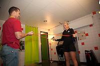 18-12-10, Tennis, Rotterdam, Reaal Tennis Masters 2010, Michaella Krajicek werkt voor haar partij aan haar warming up met haar coach Allister McCaw