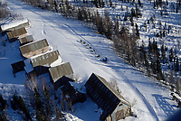 Aerial of Team Near Buildings on Trail to Ophir