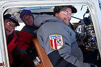 Volunteer pilot Diana Moroney in the cockpit with two veterinarians at the 1/2 way point of Cripple during the 2010 Iditarod