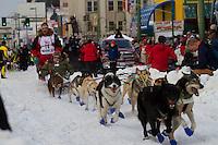 2010 Iditarod Ceremonial Start in Anchorage Alaska musher # 16 MIDDIE JOHNSON with Iditarider GERALD ELKAN