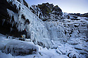 "20/01/16<br /> <br /> Only 160 miles, as the crow flies from central London, Will Flanagan (36), explores the stunning icicles at Kinder Downfall near Hayfield in the Derbyshire Peak district today. After days of cold sub-zero temperatures the 100 ft waterfall finally froze over last night.<br /> <br /> Will said: ""I had to set off at dawn to to get up here. I've been watching the overnight temperatures and thought there's be a chance it would be frozen today. <br /> <br /> ""As the sun began to rise the ice started to melt. I could here it cracking beneath my feet and I saw a few giant icicles crash down. So I didn't stay up there very long!<br /> <br /> ""I definitely wouldn't have wanted to climb any higher up it today even if I'd had ropes with me - the ice wouldn't have been strong enough to support me. If I'd have arrived any later I wouldn't have risked going all the way up. <br /> <br /> ""But all the same it was an awesome spectacle and one of the most extreme walks I've ever done.""<br /> <br /> The waterfall flows from Kinder Scout the only mountain in the Derbyshire Peak District between Hayfield and Edale. <br /> <br /> <br /> All Rights Reserved: F Stop Press Ltd. +44(0)1335 418365   www.fstoppress.com."
