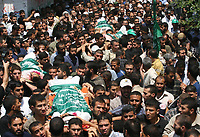 Palestinian mourners carry the bodies of 6 Hamas militants were killed by an Israeli air strike, during their funeral in Buraije refugee camp, Centeral Gaza Strip, Tuesday, Aug. 21, 2007. (FADY ADWAN)