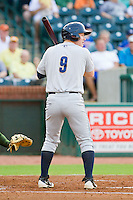 Aaron Gates (9) of the Charleston RiverDogs at bat against the Greensboro Grasshoppers at NewBridge Bank Park on July 17, 2013 in Greensboro, North Carolina.  The Grasshoppers defeated the RiverDogs 4-3.  (Brian Westerholt/Four Seam Images)