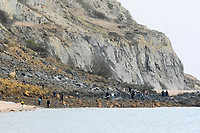 BNPS.co.uk (01202 558833)<br /> Pic: Graham Hunt/BNPS<br /> <br /> People ignoring safety advice to keep clear of the huge cliff fall at Seatown in Dorset.<br /> <br /> Visitors scrambling over the bottom of the landslip looking for fossils.