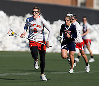 Laura Merrifield (9) carries the ball past the Richmond defense at the practice turf field in College Park, Maryland.  Maryland defeated Richmond, 17-7.