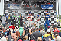 #60 KohR Motorsports Ford Mustang GT4, GS: Nate Stacy, Kyle Marcelli, #39 Carbahn Motorsports Audi R8, GS: Tyler McQuarrie, Jeff Westphal, #80 BimmerWorld Racing BMW M4 GT4, GS: Ari Balogh, Mike Skeen celebrate the win the podium with champagne