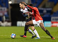 Bolton Wanderers' Gethin Jones (left) competing with from Salford City's Di'Shon Bernard<br /> <br /> Photographer Andrew Kearns/CameraSport<br /> <br /> The EFL Sky Bet League Two - Bolton Wanderers v Salford City - Friday 13th November 2020 - University of Bolton Stadium - Bolton<br /> <br /> World Copyright © 2020 CameraSport. All rights reserved. 43 Linden Ave. Countesthorpe. Leicester. England. LE8 5PG - Tel: +44 (0) 116 277 4147 - admin@camerasport.com - www.camerasport.com