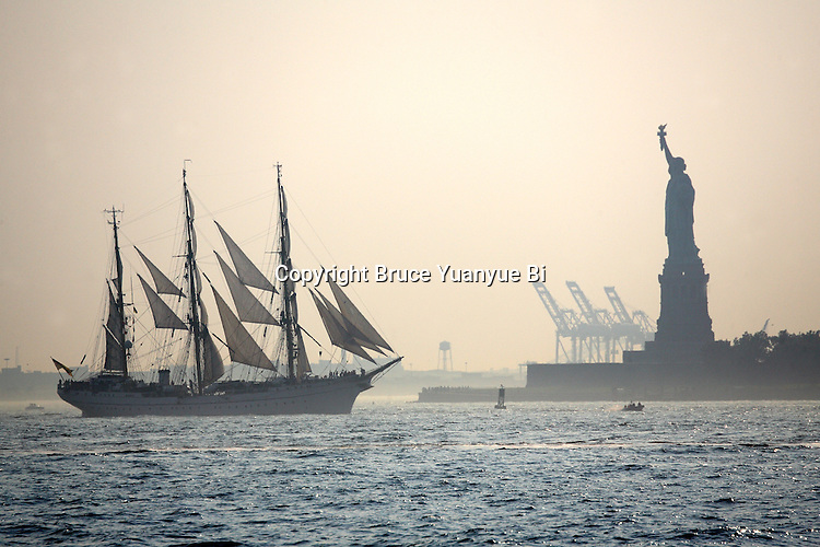 A sailing ship and Statue of Liberty in Upper New York Bay, New York City. USA