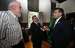From left, Nevada State Museum Curator Bob Nylen, Wells Fargo Regional President Kirk V. Clausen and Gov. Brian Sandoval talk before a ceremony marking the beginning of production of the third medallion in the four-part Sesquicentennial series, at the Nevada State Museum in Carson City, Nev., on Friday, May 30, 2014. <br /> Photo by Cathleen Allison