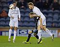 Raith Rovers' Jason Thomson gets above Dundee's Martin Boyle.