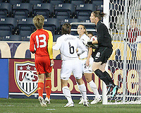 Nicole Barnhart #18 of the USA WNT grabs the ball in front of Jun Ma #13 of the PRC WNT during an international friendly match at PPL Park, on October 6 2010 in Chester, PA. The game ended in a 1-1 tie.