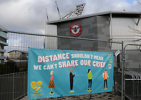 A sign outside Brentford FC reads, Distance shouldn't mean we can't share our grief during Brentford vs Reading, Sky Bet EFL Championship Football at the Brentford Community Stadium on 19th December 2020