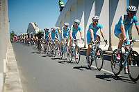 Team Astana leading the peloton over the Saône River Bridge with yellow jersey Vincenzo Nibali (ITA/Astana) safely tucked away behind them<br /> <br /> 2014 Tour de France<br /> stage 12: Bourg-en-Bresse - Saint-Etiènne (185km)