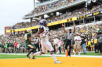 TCU tackle B.J. Catalon (23) rushes past Baylor safety Orion Stewart (28) for a touchdown during an NCAA football game, Saturday, October 11, 2014 in Waco, Tex. Baylor defeated TCU 61-58 to remain undefeated in BIG 12 conference. (Mo Khursheed/TFV Media via AP Images)