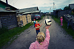 Children are playing ball in a village street. Most of them come to Kenozero just to spend their summer holidays