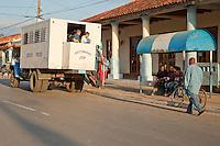 Cuba, Pinar del Rio Region, Viñales (Vinales).  Cubans Disembarking from Local Transport.