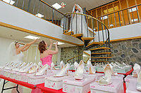 """COPY BY TOM BEDFORD<br /> Pictured L-R: Members of staff Sara Morris, Michelle Curry and Lara Williams, have fun while being dressed with some of the dresses at the John Pye Auctions warehouse in Pyle, south Wales, UK.<br /> Re: A bride cried tears of joy after her missing wedding dress was found among a pile of 20,000 gowns in a warehouse.<br /> Meg Stamp, 27, paid £1,300 for the beautiful ivory lace dress but it  was seized by liquidators after a bridal company went bust.<br /> It was boxed up along with 20,000 others and due to be sold for a knock-down price at auction.<br /> But determined Meg banged on the auctioneer door saying: """"I want my dress back"""".<br /> Staff at John Pye auctioneers in Port Talbot spent three hours sifting through boxes until they finally found Meg's dream dress."""