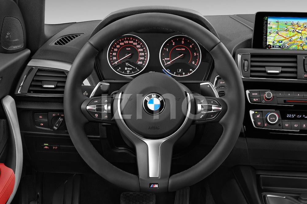 Car pictures of steering wheel view of a 2015 BMW 1 Series M Sport 3 Door Hatchback Steering Wheel