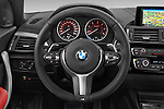 Car pictures of steering wheel view of a 2015 BMW 1 Series M Sport 3 Door Hatchback Steering Wheel