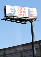 COLLEGE PARK, GA - JANUARY 5: A sign with the photo of deceased civil rights activist, John Lewis encouraging drivers to vote on I285 around the area leading to downtown Atlanta during the Georgia Senate runoff races on January 5, 2021 in College Park, Georgia. <br /> CAP/MP34<br /> ©MPI34/Capital Pictures