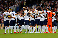 11th September 2021; Selhurst Park, Crystal Palace, London, England;  Premier League football, Crystal Palace versus Tottenham Hotspur: Tottenham Hotspur starting lineup all stand for a minute silence in remembers of 9/11