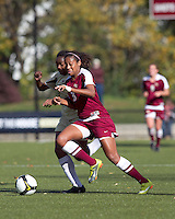 Florida State midfielder Casey Short (3) dribbles as Boston College forward Natalie Crutchfield (9) closely defends. Florida State University defeated Boston College, 1-0, at Newton Soccer Field, Newton, MA on October 31, 2010.