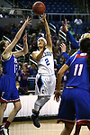 Centennial's Melanie Isbell shoots past Reno defenders during the NIAA Division I state basketball tournament in Reno, Nev. on Thursday, Feb. 25, 2016. Centennial won 82-53. Cathleen Allison/Las Vegas Review-Journal
