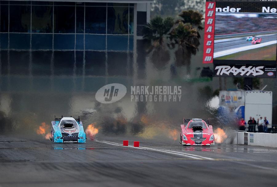 Mar. 11, 2012; Gainesville, FL, USA; NHRA funny car driver Cruz Pedregon (right) races alongside Tim Wilkerson during the Gatornationals at Auto Plus Raceway at Gainesville. Mandatory Credit: Mark J. Rebilas-