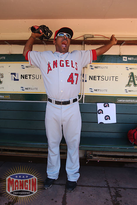 OAKLAND, CA - SEPTEMBER 4:  Howard Kendrick of the Los Angeles Angels of Anaheim stands in the dugout and yawns before the game against the Oakland Athletics at the Oakland-Alameda County Coliseum on September 4, 2010 in Oakland, California. Photo by Brad Mangin