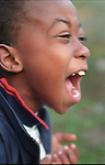 African American boy (6 years) screaming