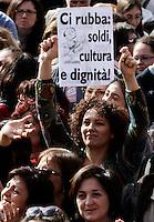 """""""Se non ora quando?"""": manifestazione contro il presidente del consiglio, per il rispetto della dignita' e dei diritti delle donne, a Roma, 13 febbraio 2011..Women attend the """"If not now, when?"""" rally against the Italian premier, to ask for respect of their dignity and rights, in Rome, 13 february 2011..The sign, depicting Silvio Berlusconi, reads: """"He steals our money, culture and dignity""""..UPDATE IMAGES PRESS/Riccardo De Luca"""