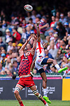 Perry Baker of USA (R) jumps for gets the ball against Cai Devine of Wales (L) during the HSBC Hong Kong Sevens 2018 match between USA and Wales on April 7, 2018 in Hong Kong, Hong Kong. Photo by Marcio Rodrigo Machado / Power Sport Images