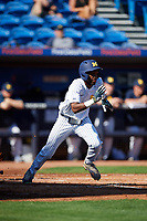 Michigan Wolverines right fielder Christan Bullock (5) runs to first base during a game against Army West Point on February 18, 2018 at Tradition Field in St. Lucie, Florida.  Michigan defeated Army 7-3.  (Mike Janes/Four Seam Images)
