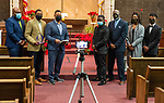WATERBURY, CT-011621JS06- Members of the Waterbury Fellowship of Christian Churches, from left, Pastor Antwaun Richardson from the Zion Baptist Church; Pastor Kristopher S. Reese from Grace Baptist Church and  Pastor Kelsey Hopson of Mount Olive AME Zion Church, presented the Dr. Martin Luther King, Jr. award for dedication and service to the community ,to members of the Waterbury NAACP Pride Youth Council, including President Amari Brantley; Advisor Kevin Clark; Treasurer Asia Chapman and Education Chairman Brandon Pittman Saturday at Mount Olive Baptist Church in Waterbury.  Due to COVID restrictions, the event was videotaped to be broadcasted later. <br /> Jim Shannon Republican-American