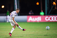 LAKE BUENA VISTA, FL - JULY 20: Oriol Rosell #20 of Orlando City SC kicks the ball during a game between Orlando City SC and Philadelphia Union at Wide World of Sports on July 20, 2020 in Lake Buena Vista, Florida.