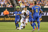 PHILADELPHIA, PENNSYLVANIA - JUNE 30: Gyasi Zardes #9, Elson Hooi #18, Jurich Carolina #5 during the 2019 CONCACAF Gold Cup quarterfinal match between the United States and Curacao at Lincoln Financial Field on June 30, 2019 in Philadelphia, Pennsylvania.