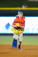 A young fan competes in a between inning contest during the Carolina League game between the Lynchburg Hillcats and the Winston-Salem Dash at BB&T Ballpark on August 13, 2014 in Winston-Salem, North Carolina.  The Hillcats defeated the Dash 4-3.   (Brian Westerholt/Four Seam Images)