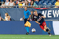 FOXBOROUGH, MA - JULY 7: Adam Buksa #9 of New England Revolution on the attack during a game between Toronto FC and New England Revolution at Gillette Stadium on July 7, 2021 in Foxborough, Massachusetts.