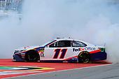 #11: Denny Hamlin, Joe Gibbs Racing, Toyota Camry FedEx Office celebrates his win with a burnout