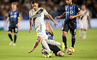 CARSON, CA - SEPTEMBER 21: Samuel Piette  #6 of  Montreal Impact slide tackles Cristian Pavon #10 of the Los Angeles Galaxy during a game between Montreal Impact and Los Angeles Galaxy at Dignity Health Sports Park on September 21, 2019 in Carson, California.