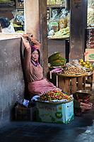 Yogyakarta, Java, Indonesia.  Woman Selling Pappers and Fruit, Beringharjo Market.